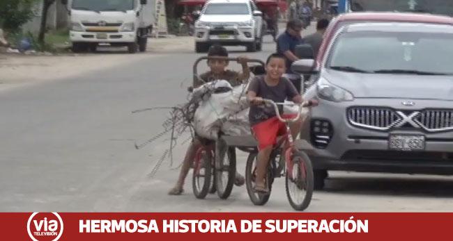 Niños adaptan carreta a sus bicicletas para trabajar como recicladores